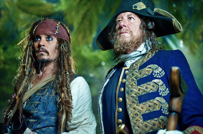 """PIRATES OF THE CARIBBEAN: ON STRANGER TIDES""Captain Jack Sparrow (JOHNNY DEPP) and his old nemesis Captain Barbossa (GEOFFREY RUSH) are thrown together by fate in the search for the Fountain of Youth.Ph: Peter Mountain©Disney Enterprises, Inc. All Rights Reserved."