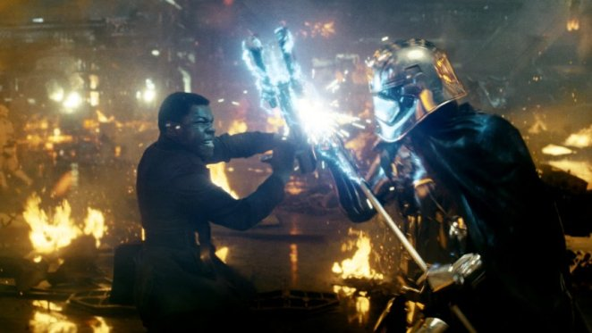 Star Wars: The Last Jedi..L to R: Finn (John Boyega) battling Captain Phasma (Gwendoline Christie)..Photo: Lucasfilm Ltd. ..Ā© 2017 Lucasfilm Ltd. All Rights Reserved.