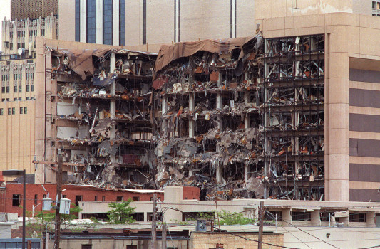 OKLAHOMA CITY, OK - APRIL 19: This 19 April 1995 file photo shows the north side of the Albert P. Murrah Federal Building in Oklahoma City and the devastation caused by a fuel and fertilizer truck bomb detonated in front of the building. The blast, the worst terrorist attack on US soil, killed 168 people and injured more than 500. Timothy McVeigh, convicted on first-degree murder charges for the 19 April bombing was sentenced to death in 1997. (Photo credit should read BOB DAEMMRICH/AFP/Getty Images)
